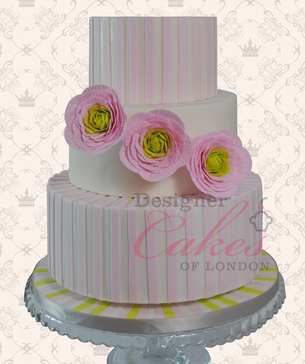 Pink designer wedding cake with flowers