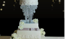 Jennai – Asian wedding cake with crystal drape and chandelier waterfall stand